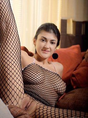 Zita B poses in her fishnet...